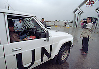 Media watch as  <br /> UN weapons inspectors arrive at an industrial site in February 1998 to look for WMDs (weapons of mass destruction). The UNSCOM weapons inspectors left Iraq later that year.<br /> <br /> <br /> <br /> &copy;Fredrik Naumann/Felix Features