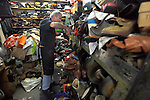 Misak Pirinjian who owns Tony's Shoe and Luggage repair shop is a very popular spot now a days during this economy since people are are more likely to repair their shoes then buy new ones, in Mill Valley, California