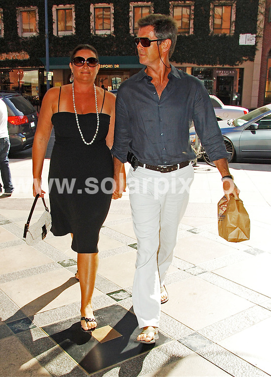 **ALL ROUND PICTURES FROM SOLARPIX.COM**.**WORLDWIDE SYNDICATION RIGHTS EXCEPT FOR USA, AUSTRALIA & GERMANY**.The Hollywood actor Pierce Brosnan with his wife leaving the medical centre with a bag full of medication in Beverly Hills California in the USA..JOB REF:7197-LAS       DATE:03_09_08.**MUST CREDIT SOLARPIX.COM OR DOUBLE FEE WILL BE CHARGED* *UNDER NO CIRCUMSTANCES IS THIS IMAGE TO BE REPRODUCED FOR ANY ONLINE EDITION WITHOUT PRIOR PERMISSION*