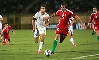 Italy's Gianvito Misuraca (11)loses control of the ball to Hungary's Andras Debreceni (5) to the ball during the FIFA Under 20 World Cup Quarter-final match at the Mubarak Stadium  in Suez, Egypt, on October 09, 2009. Hungary won 2-3 in overtime.