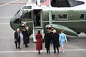 Former United States President Barack Obama and Michelle Obama stand with US President Donald Trump and Melania Trump in front of Marine One on the East front as Obama departs from the 2017 Presidential Inauguration at the US Capitol in Washington, DC on January 20, 2017.<br /> Credit: Jack Gruber / Pool via CNP