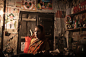 Jamsed Gazi's second wife and Siraj's step-mother, Murjina Bibi seen inside her house in Chaymalpur village of North 24 Parganas in West Bengal, India. Photo: Sanjit Das/Panos for The Wall Street Journal. Slug: ICASTE