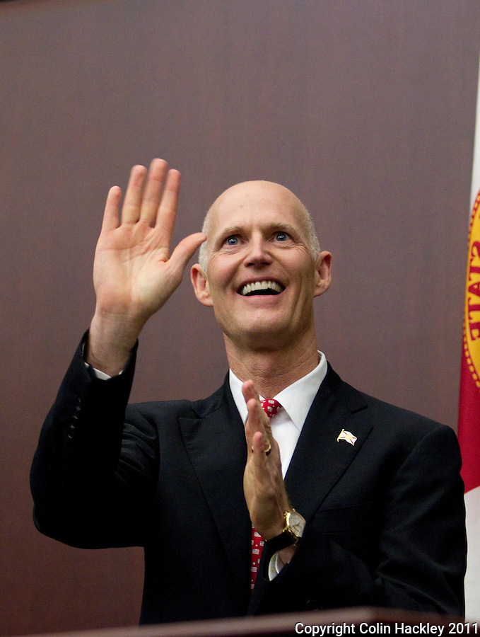 TALLAHASSEE, FLA. 3/8/11-OPENINGDAY030811 CH-Gov. Rick Scott waves to the gallery prior to giving his first State of the State address Tuesday at the Capitol in Tallahassee..COLIN HACKLEY PHOTO