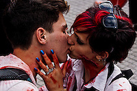 A couple kiss each other while revellers take part in the annual Zombie Walk in Buenos Aires October, 2013. Photo by Juan Gabriel Lopera / VIEWpress.