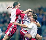 Ally McCoist celebrates scoring with Ian Durrant and Alec Cleland in November 1996 at Starks Park