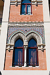 decorated window in old building in sevilla, spain