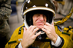 U2 pilot Major Eric Shontz wriggles into his pressurized flight suit before a &quot;high-flight&quot; at Beale Air Force Base February 24, 2010 in Linda, Calif.