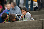 Vancouver, Canada, Aug 8th 2009. World Police and Fire Games, Dragon Boat Competition.  Some young spectators enjoy the races held at the Plaza of Nations in Vancouver, Canada.  Photo by Gus Curtis