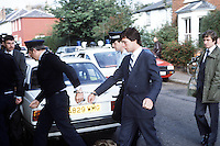 Pix: Copyright Anglia Press Agency/Archived via SWpix.com. The Bamber Killings. August 1985. Murders of Neville and June Bamber, daughter Sheila Caffell and her twin boys. Jeremy Bamber convicted of killings serving life...copyright photograph>>Anglia Press Agency>>07811 267 706>>..Jeremy Bamber, lead in handcuffs, at Maldon Magistrates Committal. no date..ref 0008 neg 7..
