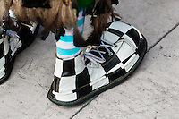 A clown wears oversized chessboard like shoes during the Clown Congress in San Salvador, El Salvador, 18 May 2011. The clown performance is considered a regular job in most of Latin American countries. Clowns may work individually or in groups, often performing advertisement like acts in large open-to-street shops or they take part in private shows, like children birthdays, family events etc. There are many clown conventions all over Latin America where clowns gather and exchange their experiences offering workshops of the comic acting or the art of make-up. For some of them, being clown is a serious lifetime profession.