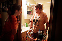 "Kara greets Kayla in the bathroom when she gets home from work at Little Caesars Pizza. ""I look up to her strength to go through all of this but still crack jokes and everything,"" Kara said."