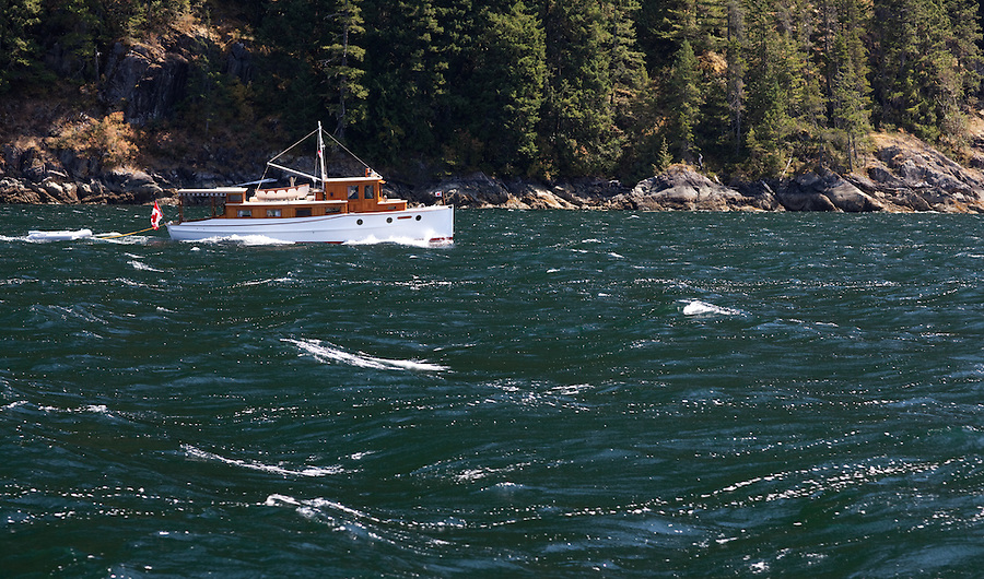 The Sannox, a small 20th century restored wooden boat is seen making its way through choppy waters in the Jervis Inlet along the coast of British Columbia.