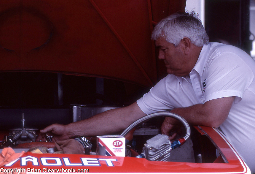The legendary Junior Johnson works under the hood of Darrell Waltrip's Chevrolet Monte Carlo at the Southern 500 at Darlington Raceway in Darlington SC on September 1, 1985. (Photo by Brian Cleary/www.bcpix.com)