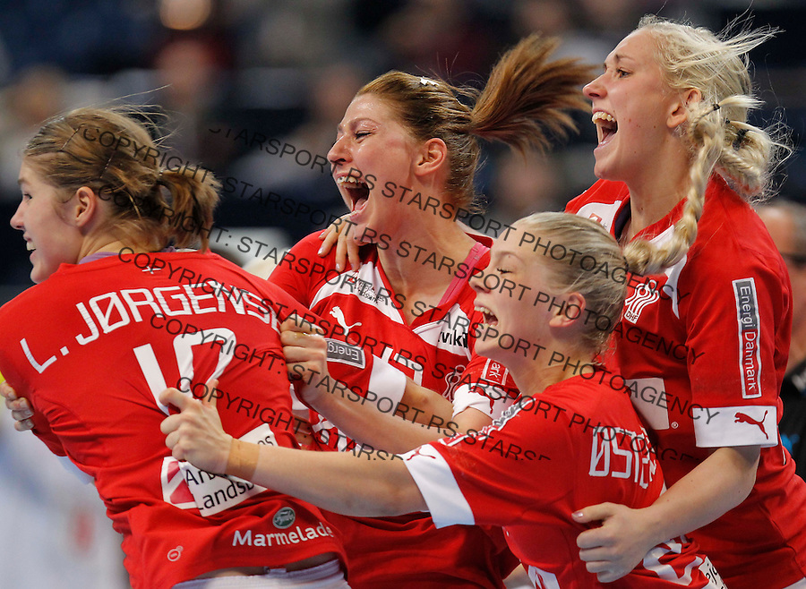 BELGRADE, SERBIA - DECEMBER 15:  Denmark team celebrate victory against Montenegro after the 2013 World Women's Handball Championship 2013 match between Denmark and Montenegro at Kombank Arena Hall on December 15, 2013 in Belgrade, Serbia. (Photo by Srdjan Stevanovic/Getty Images)