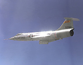 """1965 photo of an F-104 in flight.  Known as """"the missile with a man in it,"""" the stubby-winged Lockheed F-104 Starfighter was the first U.S. jet fighter in service to fly Mach 2, twice the speed of sound. Designed as a high-performance day fighter, the F-104 had excellent acceleration and top speed. It first flew on February 7, 1954.   While built for the United States Air Force, most Starfighters were flown by other countries, particularly Canada, Italy, Germany, and Japan. Many were built under license overseas.  The National Aeronautics and Space Administration (NASA) flew this F-104A for 19 years as a flying test bed and a chase plane. It was used to test the reaction controls later used on the North American X-15. .Credit: U.S. Air Force via CNP"""