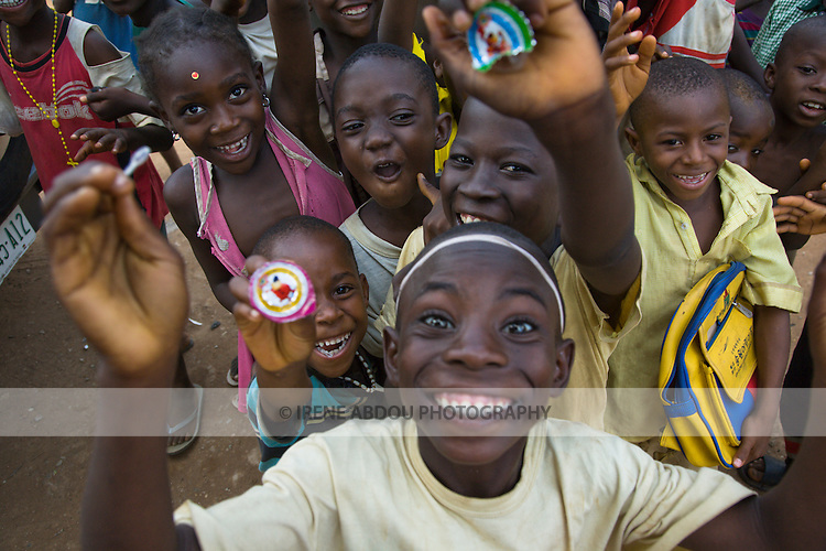 Children crowd up to the camera in the Durumi area of Abuja, Nigeria.
