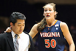 02 January 2012: Virginia's Chelsea Shine, supported by trainer Paul Murata, leaves the court bleeding from her mouth. The Duke University Blue Devils defeated the University of Virginia Cavaliers 77-66 at Cameron Indoor Stadium in Durham, North Carolina in an NCAA Division I Women's basketball game.