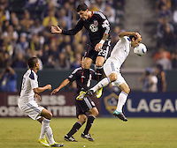 DC United midfielder Santino Quaranta battles with LA Galaxy midfielder Landon Donovan. The LA Galaxy defeated DC United 2-1at Home Depot Center stadium in Carson, California on Saturday September 18, 2010.