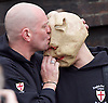 Far right activists protesting outside Regent's Park Mosque in Central London, Great Britain <br /> 3rd April 2015 <br /> <br /> <br /> Members of the English Defence League <br /> <br /> kissing the pig <br /> <br /> Photograph by Elliott Franks <br /> Image licensed to Elliott Franks Photography Services