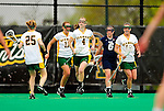 1 May 2010: University of Vermont Catamount attacker Kaitlyn Fuller (4), a Senior from Jordan, NY, trots back to center field after celebrating a goal against the University of New Hampshire Wildcats at Moulton Winder Field in Burlington, Vermont. The Lady Catamounts fell to the visiting Wildcats 18-10 in the last game of the 2010 regular season. Mandatory Photo Credit: Ed Wolfstein Photo