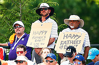 Fans hold up Father's Day signs on the 1st tee during the 2016 U.S. Open in Oakmont, Pennsylvania on Sunday June 19, 2016. (Photo by Jared Wickerham / DKPS)