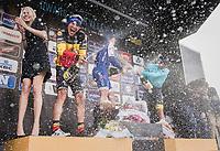 Champaign shower for winner Yves Lampaert (BEL/QuickStep Floors), Philippe Gilbert (BEL/Quick Step floors) &amp; Alexey Lutsenko (KAZ/Astana) on the podium<br /> <br /> 72nd Dwars Door Vlaanderen (1.UWT)<br /> 1day race: Roeselare &rsaquo; Waregem BEL (203.4km)