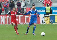 20 October 2012: Toronto FC midfielder Eric Avila #8 and Montreal Impact defender Dennis Iapichino #17 in action  during an MLS game between the Montreal Impact and Toronto FC at BMO Field in Toronto, Ontario Canada. .The ended in a 0-0 draw..