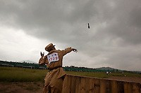 A competitor dressed in a PLA (People's Liberation Army) revolutionary era outfit throws dummy hand grenades in the 'Hand Grenade Tossing' event at the Red Games. Held in Junan County, this sporting event is a nostalgic tribute to the communist era.