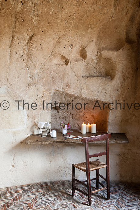 A writing table made with a slab of marble inserted in the wall in one of the bedrooms at the unique Albergo Diffuso Le Grotte della Civita in Southern Italy housed in restored caves