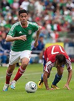 Pablo Barrera (7) escapes his defender, Aureliano Torres (17). Mexico defeated Paraguay 3-1 at the Oakland Coliseum in Oakland, California on March 26th, 2011.