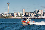 US Coast Guard patrol boats escort the ferry to Bainbridge Island out of Seattle harbor, as part of maritime anti-terrorism security.