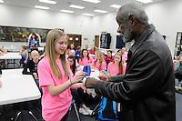 NWA Democrat-Gazette/ J.T. WAMPLER -- Former University of Arkansas basketball coach Nolan Richardson  signs an autograph for 9th grader Catherine Huck after speaking to Central Junior High School basketball players Thursday Feb. 12, 2015.