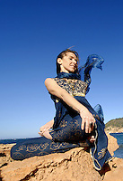 MR Yoga teacher and artist Lena Tancredi doing yoga on a the rocks of Ibiza
