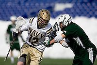 Kevin Doyle (12) of Navy is checked by Josh Hawkins (5) of Loyola at the Navy-Marine Corp Memorial Stadium in Annapolis, Maryland.   Loyola defeated Navy, 8-7, in overtime.