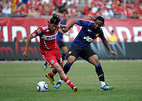 Chicago Fire midfielder Sebastian Grazzini (10) is pressured by Manchester United midfielder Anderson (8).  Manchester United defeated the Chicago Fire 3-1 at Soldier Field in Chicago, IL on July 23, 2011.