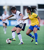 Abby Wambach (20) of the USWNT fights for the ball with Calandrini (3) of Brazil during an international friendly at the Florida Citrus Bowl in Orlando, FL.  The USWNT defeated Brazil, 4-1.