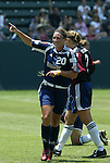 27 June 2004: Abby Wambach (20) celebrates in front of goalkeeper Kristen Luckenbill (2) after her 61st minute goal had given San Diego a 1-0 lead. The San Diego Spirit defeated the Carolina Courage 2-1 at the Home Depot Center in Carson, CA in Womens United Soccer Association soccer game featuring guest players from other teams.