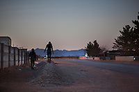 Two young girls walk down a road in Columbus, New Mexico. Recently federal authorities arrested the mayor, police chief, and trustees who were allegedly operating an illegal gun running ring.