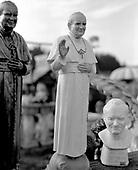 Szaflary, Poland March 3, 2011:.Two resin monuments of pope John Paul 2 for sale at the roadside shop, alongside with garden gnomes and other garden figures.. (Photo by Piotr Malecki / Napo Images)..Szaflary, 3/03/2011:.Dwie figury papieza Jana Pawla II zrobione z zywicy, na sprzedaz w przy droznym sklepie..Fot: Piotr Malecki / Napo Images