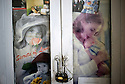 Photographs and posters of mothers and babies are pasted on the hospital cabinets in the doctors offices of Faizabad Provincial Hospital. Badakshan, Afghanistan, 2012