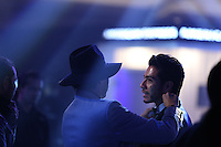 A gentleman adjusts the bow tie of a wizard during the Mercedes Benz Fashion Week Mexico Spring/Summer 2015, in Mexico City, 09.30.2014. VIEWpress / Miguel Angel Pantaleon