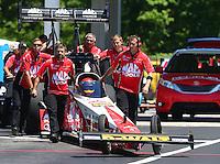 May 15, 2016; Commerce, GA, USA; NHRA top fuel driver Doug Kalitta with crew members during the Southern Nationals at Atlanta Dragway. Mandatory Credit: Mark J. Rebilas-USA TODAY Sports