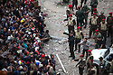 Egyptian army soldiers try to convince anti-Mubarak protesters to allow them to dismantle barricades during ongoing protests February 05, 2011 in Tahrir Square in downtown Cairo, Egypt. Overnight the army appeared to tighten its control of the no man's land around the square and made efforts today to convince protesters to leave voluntarily. . .Credit: Scott Nelson