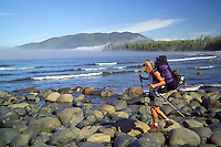 Nootka Island, British Columbia, Canada, August 2006. The stretch between Calvin Creek Beach and Beano creek is littered with slick round black rocks that have to be negotiated. Trekking the Nootka trail takes hikers through dense rainforest and along beaches full of marine life. Photo by Frits Meyst/Adventure4ever.com.