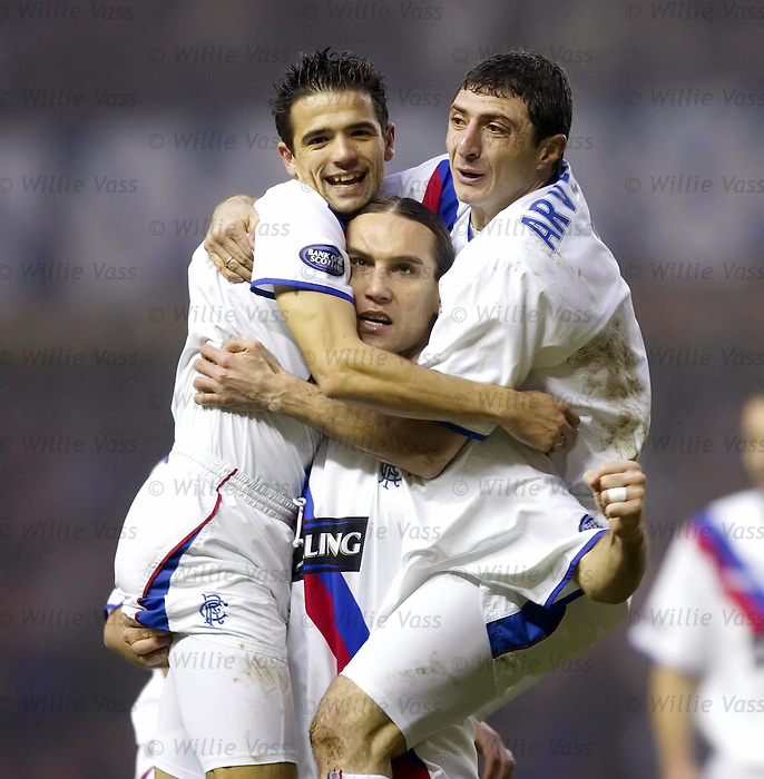 Dado Prso celebrates with Nacho Novo and Shota Arveladze