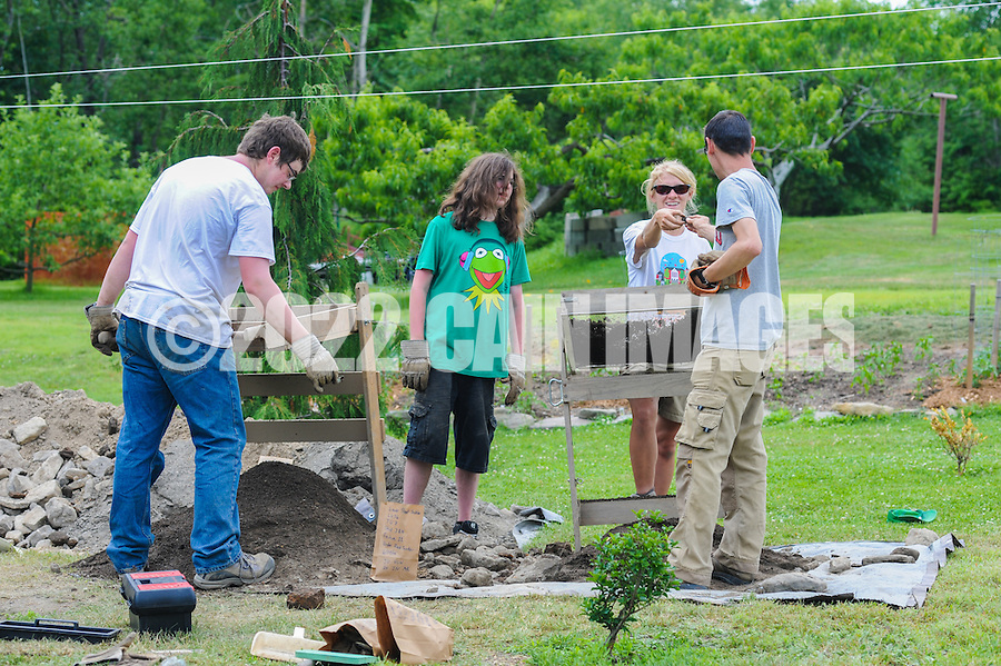 HAZLETON, PA - JUNE 30:  From left, Adam Yeager, Jonathan Nick, Camille Westmont and  Mike Roller work at the site of an archaeologic dig as a neighbor watches June 30, 2014 in Hazleton, Pennsylvania. The team is looking through sites connected with the Lattimer Massacre which occurred in 1897. (Photo by William Thomas Cain/Cain Images)