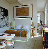Situated beneath a work by Francesco Clemente the bed in the master bedroom was designed by David Gill