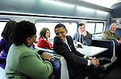Baltimore, MD - January 17, 2009 -- United States President-elect Barack Obama talks to train passengers on the Whistle Stop Train Tour outside of Baltimore, Maryland on Saturday, January 17, 2009. The ceremonial trip will carry President-elect Obama, Vice President-elect Biden and their families to Washington for their inaugurations with additional events in Philadelphia, Wilmington and Baltimore. Obama will be sworn in as the 44th President of the United States on January 20, 2009.  .Credit: Kevin Dietsch - Pool via CNP