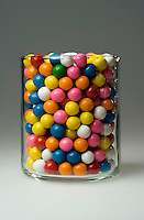 ESTIMATING A NUMBER: CANDIES IN CYLINDER<br /> (Variations Available)<br /> Colorful Gumballs<br /> Many candies in a clear cylindrical container to illustrate a problem in estimating the number.
