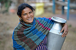 A woman carries a water pot in Makaising, a village in the Gorkha District of Nepal that was hit hard by a devastating 2015 earthquake.